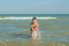 Happy  Children - boy having fun on the beach Royalty Free Stock Photography