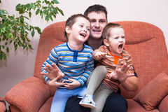 Happy children boys laughing with daddy Royalty Free Stock Photography