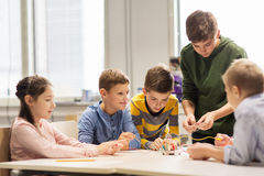 Happy children building robots at robotics school Royalty Free Stock Image