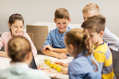 Happy children building robots at robotics school Royalty Free Stock Photo