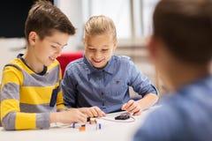 Happy children building robots at robotics school Royalty Free Stock Images