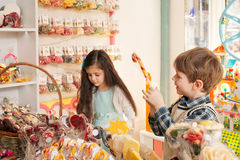 Happy children in a candy store Stock Image