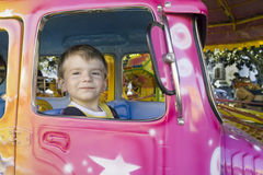 Happy children in carousel. Happy little boy in carousel Royalty Free Stock Image