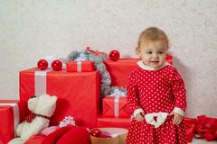 Happy children. Celebraties concept. Cute babies with a red present box on white background. Cute little child hold gift. Box stock image