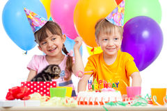 Happy children celebrating birthday party. Happy kids girl and boy celebrating birthday party royalty free stock image