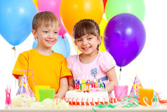 Happy children celebrating birthday party Stock Images