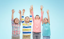 Happy children celebrating victory over blue Stock Image