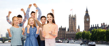 Happy children celebrating victory over london Stock Image