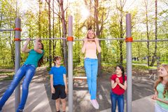 Happy children are chinning up on the playground royalty free stock images