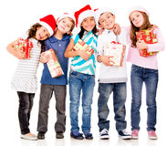 Happy children with Christmas gifts Royalty Free Stock Images