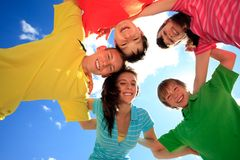 Happy children in circle. 5 happy, smiling children huddled in a circle outdoors stock image