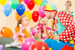 Happy children with clown on birthday party. Happy children and clown on birthday party Stock Photos