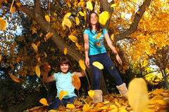 Happy Children With Colorful Fall Leaves Outdoors Royalty Free Stock Photo