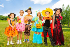 Happy children in colorful Halloween costumes Royalty Free Stock Photography