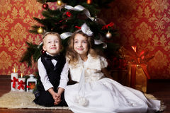 Happy children with cristmas presents Stock Photo