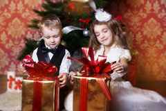 Happy children with cristmas presents Stock Images