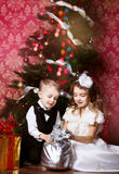 Happy children with cristmas presents Royalty Free Stock Photo