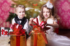 Happy children with cristmas presents Royalty Free Stock Image
