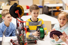 Happy children with 3d printer at robotics school Stock Photo