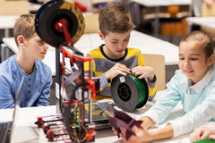 Happy children with 3d printer at robotics school. Education, children, technology, science and people concept - group of happy kids with 3d printer at robotics royalty free stock image