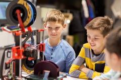 Happy children with 3d printer at robotics school Royalty Free Stock Photos