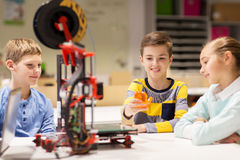 Happy children with 3d printer at robotics school Royalty Free Stock Photo