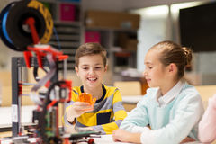 Happy children with 3d printer at robotics school Royalty Free Stock Photos