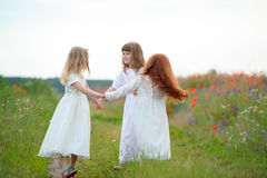 Happy children dancing on a field, healthy life, kid`s togethern. Ess and happiness concept Royalty Free Stock Image