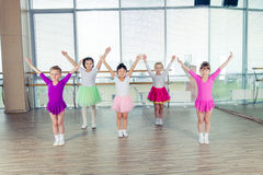 Happy children dancing on in hall, healthy life, kid's togethern. Ess and happiness concept Royalty Free Stock Photos