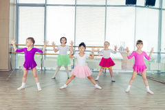 Happy children dancing on in hall, healthy life, kid's togethern. Ess and happiness concept Royalty Free Stock Photo