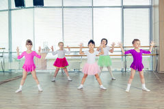 Happy children dancing on in hall, healthy life, kid's togetherness and happiness concept Royalty Free Stock Image