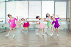 Happy children dancing on in hall, healthy life, kid's togetherness and happiness concept Stock Images