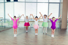 Happy children dancing on in hall, healthy life, kid's togetherness and happiness concept Stock Photography