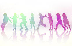 Happy children dancing together Royalty Free Stock Images