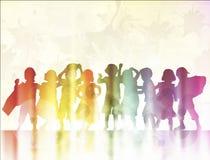 Happy children dancing together Stock Photos