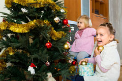 Happy children decorating christmas tree Royalty Free Stock Image