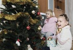 Happy children decorating christmas tree Royalty Free Stock Photos