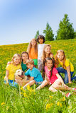 Happy children with dog together in meadow Royalty Free Stock Photo