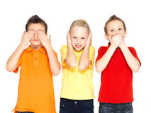 Happy children doing. Funny faces of happy children doing See Nothing, Hear Nothing, Say Nothing... isolated on white background royalty free stock photos