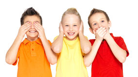 Happy children doing See Nothing, Hear Nothing Stock Photo