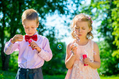 Happy children doing soap bubbles Royalty Free Stock Images