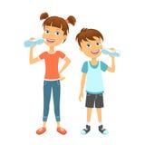 Happy children drinking water Stock Photos