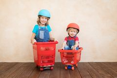 Happy children driving toy car at home stock images