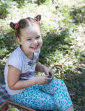 Happy children eat outdoors Stock Image