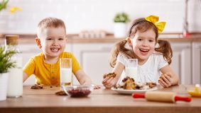 Happy children    eating biscuits and drinking milk Royalty Free Stock Image