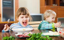 Happy children eating food Royalty Free Stock Photos