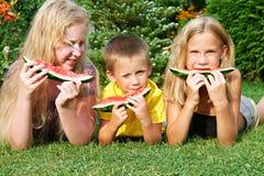 Happy children eating watermelon Stock Photo