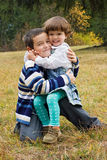 Happy children embracing to each other Stock Images
