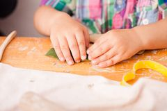 Happy children are engaged with modeling clay stock photo