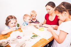 Happy children are engaged with modeling clay stock photos